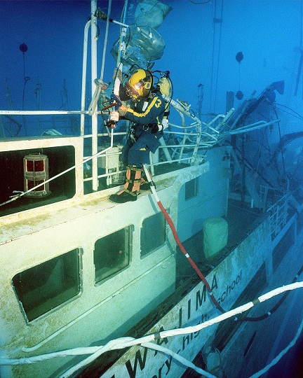 011105-N-3093M-011  --  HONOLULU, November 5, 2001  --  A deep sea diver from Mobile Diving and Salvage Unit One works his way around Ehime Maru.  The U.S. Navy divers have been working on the ship that sits approximately 115 feet below the surface.  They have recovered eight of the nine missing crewmen and over 2,000 personal items from the ship. CLEARED FOR RELEASE.  U.S. Navy photograph by PHC(SW/DV) Andrew McKaskle
